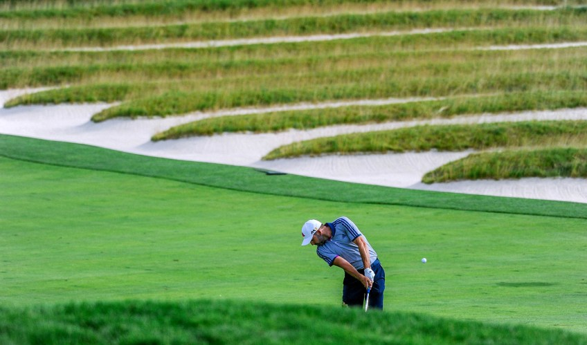 Sergio Garcia hits from the fairway on 3rd hole in in the third round . (Lake Fong/Post-Gazette)