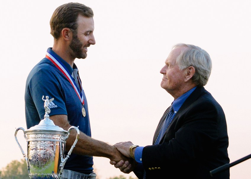 Dustin Johnson shakes hands with Jack Nicklaus on the 18th green . (Matt Freed/Post-Gazette)