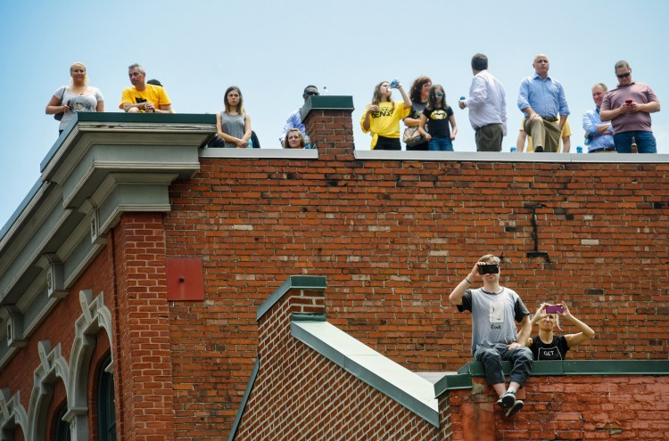 These fans had a great view from a rooftop on the boulevard. (Steve Mellon/Post-Gazette)