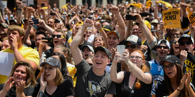 More fans on the boulevard. (Steve Mellon/Post-Gazette)