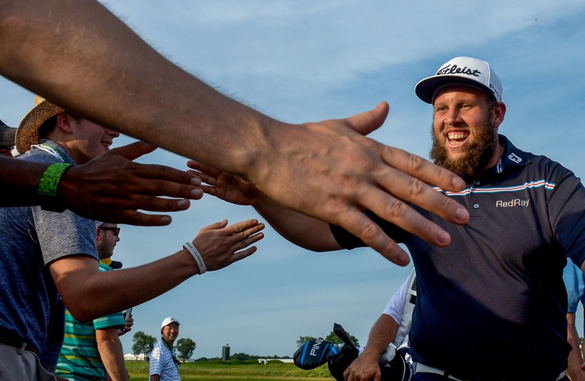 """Andrew """"Beef"""" Johnston slaps hands with fans after finishing the 8th hole during the third round. (Matt Freed/Post-Gazette)"""