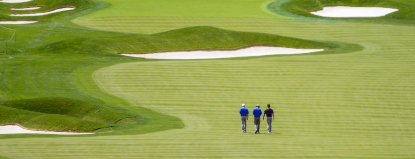 Several golfers walk the 18th hole at Oakmont, site of the 2016 U.S. Open, during practice rounds. (Steve Mellon/Post-Gazette)