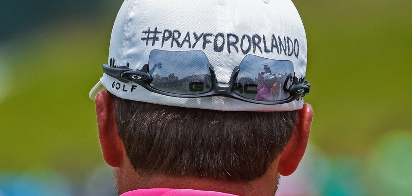 Graeme McDowell shows his support for the people of Orlando on the 13th green. (Matt Freed/Post-Gazette)