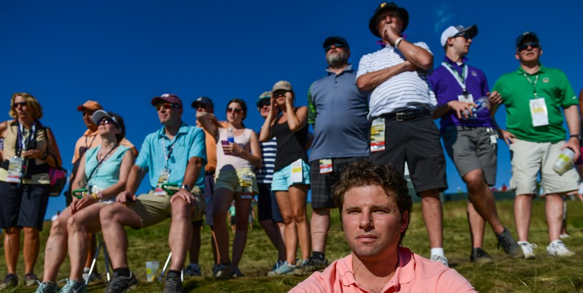 Drew Pennline of Mt. Washington watches as a group putts on hole 6 during Round 2 on Friday. (Rebecca Droke/Post-Gazette)