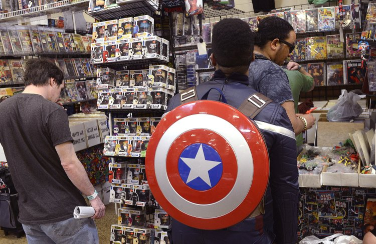 Larry Roberts/Post-Gazette    20160417   steel city con A2 layout One popular item seen carried by a number of people at Steel City Con at the Monroeville Convention Center, April 17, 2016, was the Captain America shield.  It is worn here by Will Etheridge (cq), a junior at Duquesne University.