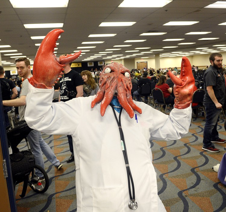 Josh Simon, from Brackenridge, tries to block the door to the costume contest at Steel City Con while made up as Dr. Zoidberg from Futurama, Aprl 17, 2016.  Simon is an amateur maker of prosthetics.