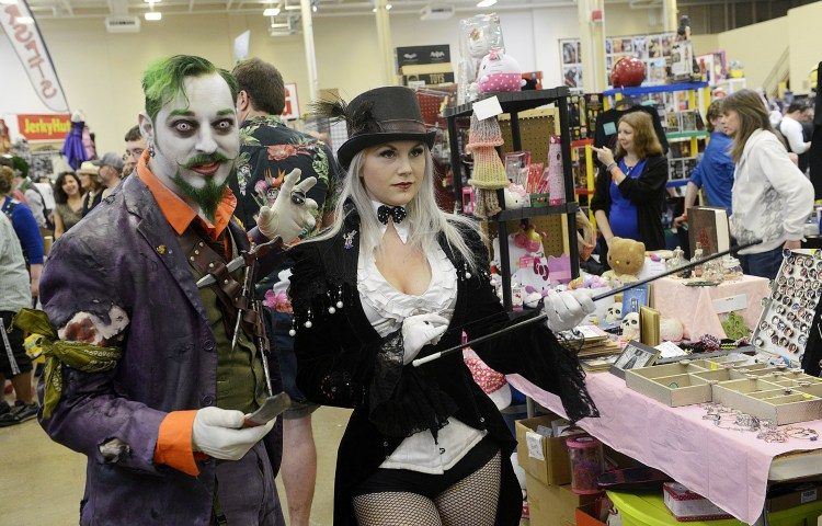 Larry Roberts/Post-Gazette    20160417   steel city con A2 layout Cosplayers Jamie Apgar (cq), as the Joker and his partner Amanda Mofitt, as Harley Quinn from Batman make their way through the aisles at Steel City Con at the Monroeville Convention Center, April 17, 2016