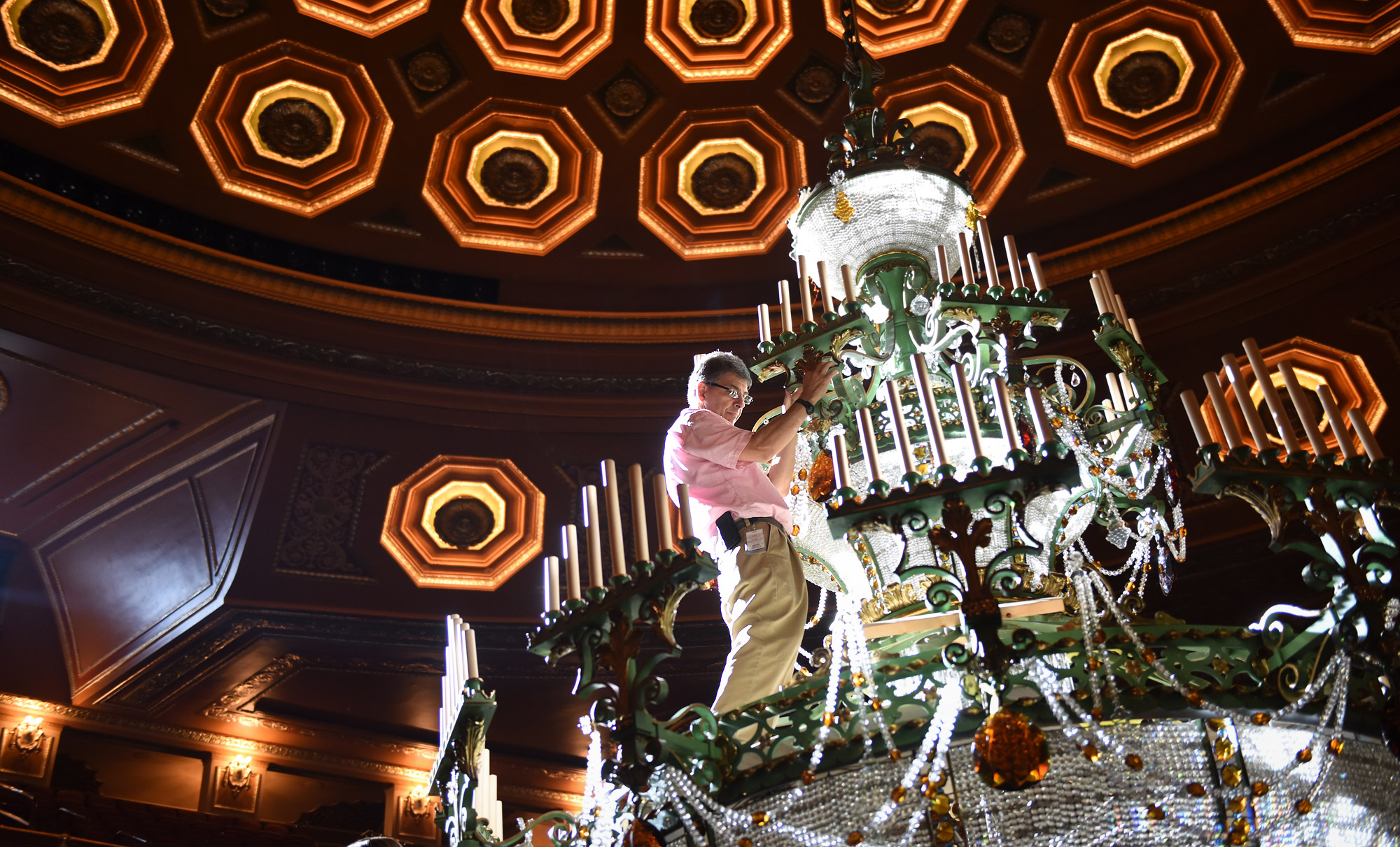 Polishing a gem pittsburgh in focus this is house electrician will dennis inside the main chandelier which was lowered to balcony level so workers could access the crystal pieces and light arubaitofo Image collections
