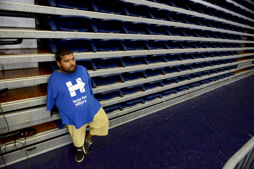 Raja Sandor, a staffer for the Pennsylvania Democratic Party, waits for the start of a campaign event featuring First Lady Michelle Obama.