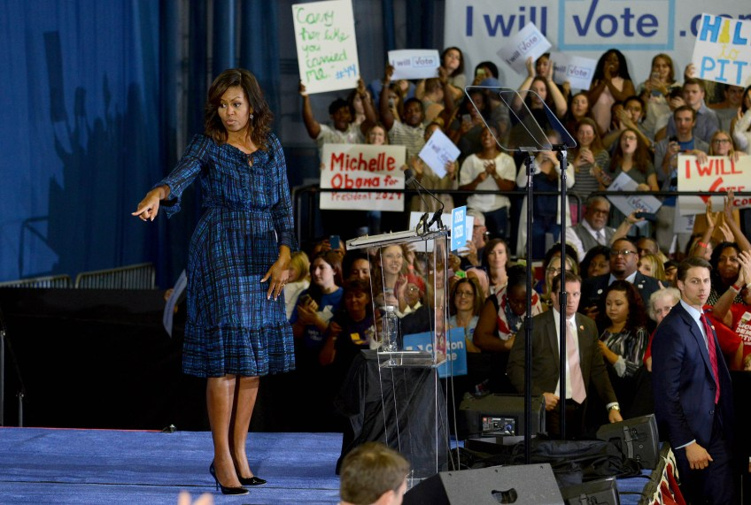 First Lady Michelle Obama greets people in the crowd.
