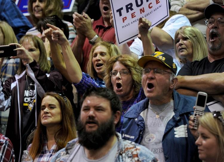 Attendees cheer as Republican Presidential candidate Donald Trump speaks at Ambridge High School. Michael Henninger/Post-Gazette