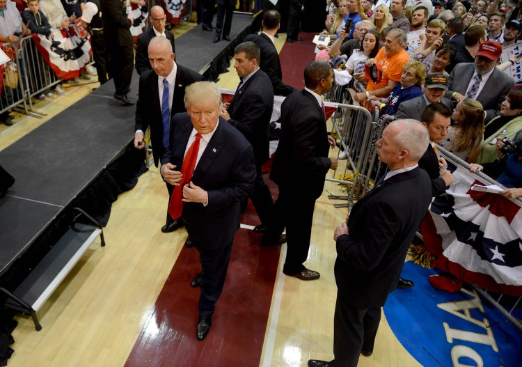 Republican Presidential candidate Donald Trump works the rope line after speaking at Ambridge High School. Michael Henninger/Post-Gazette