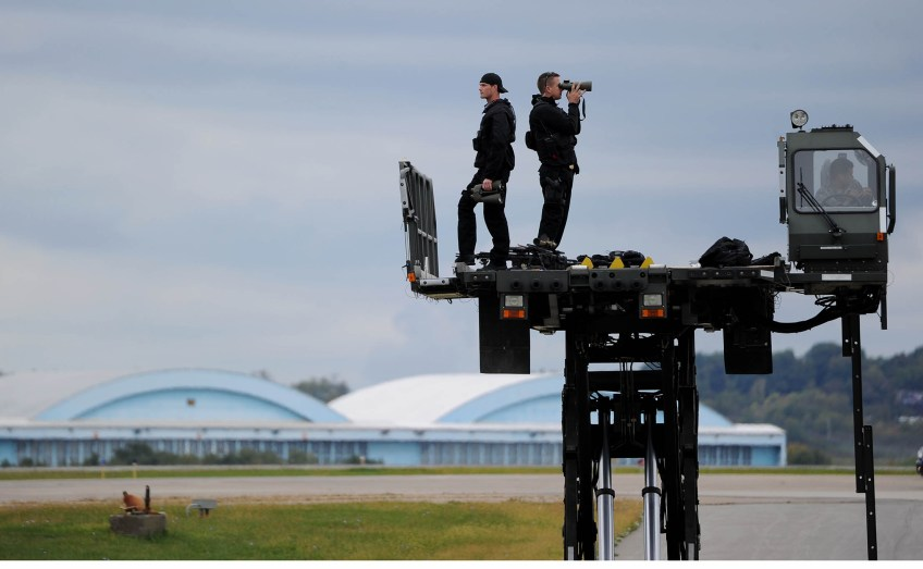 Spotters keep watch while waiting for Air Force One to land carrying President Barack Obama at the 171st Air Refueling Wing in Coraopolis. (Photo by Michael Henninger/Post-Gazette)
