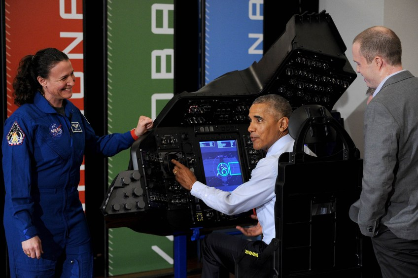 NASA Astronaut Dr. Serena Au–—non-Chancellor, left, and Boeing representative Daniel Nelson, right, guide President Barack Obama as he tries out a spacecraft flight and docking simulator inside the exhibition hall at the University of PIttsburgh for The White House Frontiers Conference on Thursday, Oct. 13, 2016. (Photo by Michael Henninger/Post-Gazette)