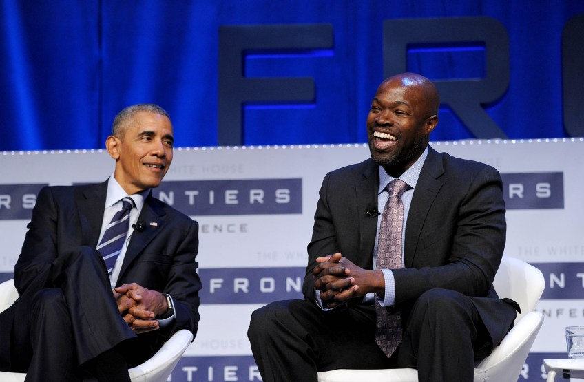 Kafui Dzirasa, MD, Ph.D., right, laughs while speaking next to President Barack Obama during a panel discussion at The White House Frontiers Conference at Carnegie Mellon University. (Photo by Michael Henninger/Post-Gazette)