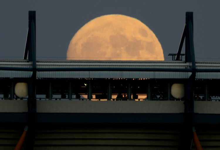 Sunday night's supermoon rises over Heinz Field on the North Shore on Nov. 13, 2016. (Michael Henninger/Post-Gazette)