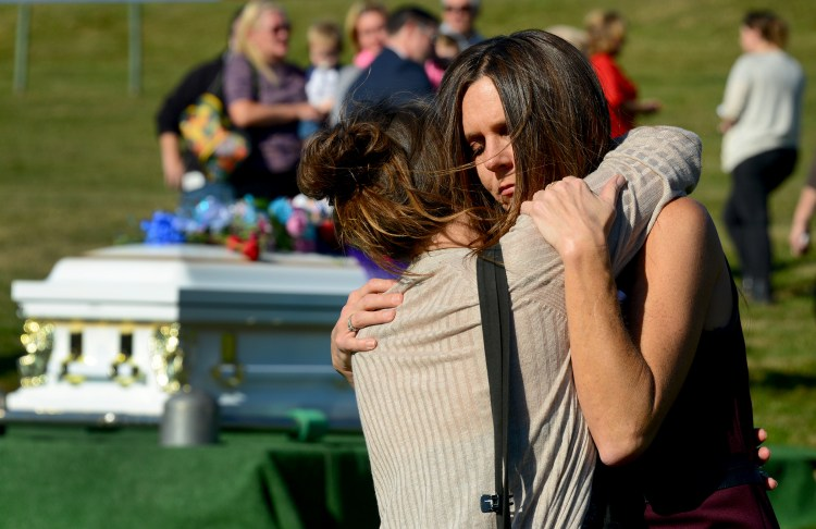 Holly Wargo, right, of Strabane and her friend Heidi Preaux of Canonsburg dance at the graveyard after the funeral service for Dalia Sabae. Dalia was three months pregnant when she was killed by her husband, Michael Cwiklinski,  the same night he ambushed Canonsburg police.