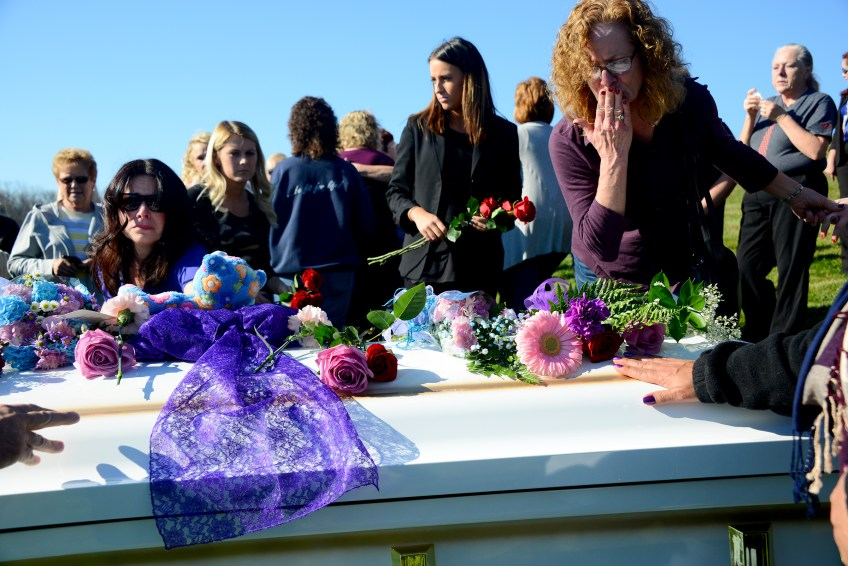Mourners lay flowers on the casket after the funeral service of Dalia Sabae at Oak Spring Cemetery in Canonsburg on Friday, November 18, 2016.