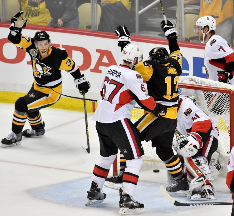 The Pittsburgh Penguins celebrate winning the Eastern Conference  championship in double overtime as Ottawa Senators center