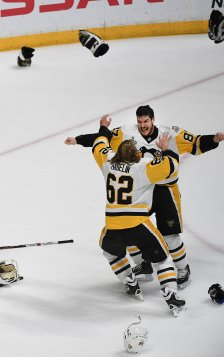 Pittsburgh Penguins Sidney Crosby celebrates winning the Stanley Cup with Carl Hagelin during after Game 6 at Bridgestone Arena on Sunday, June 11, 2017 in Nashville. (Peter Diana/Post-Gazette)