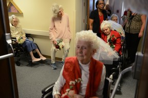 "Brides from left Jean Rosfeld, 87, Barbara Murawski, and Patricia Phoebe, foreground, 89, wait to process into the marriage vow renewal ceremony held in honor of Valentine's Day on Tuesday, Feb. 14, 2017, at Asbury Heights senior living community in Mt. Lebanon. Ten couples, including one couple married for 77 years, renewed their vows Tuesday. ""Marriage doesn't work unless God is in the mix. You can't fail with him,"" says Barbara Murawski. She married Carl Murawski in 1954. ""He's still the greatest,"" Barbara says after 62 years of marriage. (Rebecca Droke/Post-Gazette)"