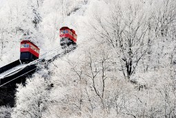 Duquesne Incline cable cars are framed by snow on Friday, Mar. 10, 2017. (Lake Fong/Post-Gazette )