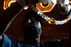 Nate Scott of the North Side cleans the main chandelier inside the Benedum Center on August, 16, 2017 Downtown. The main chandelier is the signature piece at the Benedum Center. Positioned in the center of auditorium, it weighs 4,700 pounds, is 20 feet high and 12 feet wide and decorated with 500,000 crystals. (Nate Guidry/Post-Gazette)