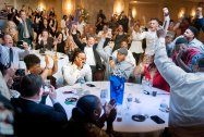 The room erupts around Malik Hooker, center, still on the phone with the Indianapolis Colts, as it is announced on TV that he will be joining their team at The Villa banquet hall on Thursday, April 27, 2017 in New Castle. Hooker was drafted by the Indianapolis Colts in the first round of the 2017 NFL Draft, and was 15th pick overall. (Haley Nelson/Post-Gazette)