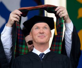 Actor and director Michael Keaton glances upward as he is given the hood for his honorary doctorate at the Carnegie Mellon University commencement ceremony in Pittsburgh on May 21, 2017. Keaton received a Doctor of Fine Arts degree. (Larry Roberts/Post-Gazette)