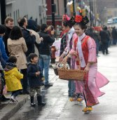 Treats are distributed along Murray Ave in Squirrel Hill, during the annual Lunar New Year parade on Feb. 12, 2017. (Larry Roberts/Post-Gazette)