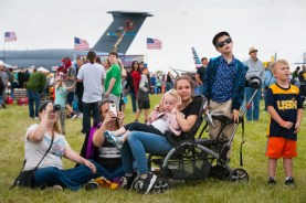 """From left to right, Colleen Fadely, 26, of Moon, looks through binoculars as she watches the Thunderbirds fly in the """"Wings over Pittsburgh"""" air show with her cousin Nicole Cunard, 35, of Glenfield, and Cunard's children Calley, 2, Shayna, 12, and Tyler, 7, and their new friend Gage Simons, 5, of Burgettstown on Sunday, May 14, 2017 in Moon. Cunard said she wanted to take her son, Tyler, to the show because he wants to be a pilot when he grows up. Tyler says he would like to be a pilot because, """"One: I have weapons. Two: I can fly."""" (Stephanie Strasburg/Post-Gazette)"""