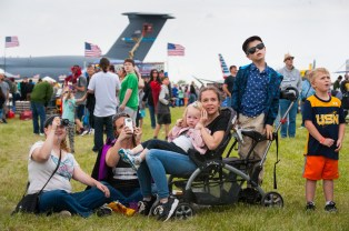 "From left to right, Colleen Fadely, 26, of Moon, looks through binoculars as she watches the Thunderbirds fly in the ""Wings over Pittsburgh"" air show with her cousin Nicole Cunard, 35, of Glenfield, and Cunard's children Calley, 2, Shayna, 12, and Tyler, 7, and their new friend Gage Simons, 5, of Burgettstown on Sunday, May 14, 2017 in Moon. Cunard said she wanted to take her son, Tyler, to the show because he wants to be a pilot when he grows up. Tyler says he would like to be a pilot because, ""One: I have weapons. Two: I can fly."" (Stephanie Strasburg/Post-Gazette)"
