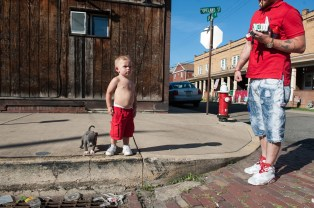 Justin Sevacko, Jr., 2, of Imperial, stands with his aunt's 6-week-old puppy, Ace, as they hang out on Tuesday, July 4, 2017 in McKees Rocks. (Stephanie Strasburg/Post-Gazette)