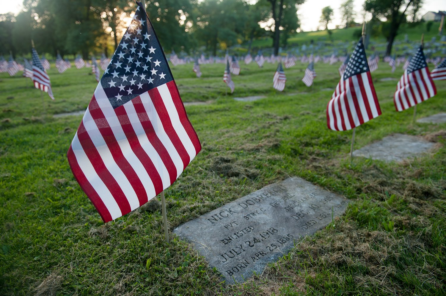 Flags on the gravesite of veterans in advance of Memorial Day, on Wednesday, May 23, 2018, at the Allegheny Cemetery in Lawrenceville.(Rebecca Droke/Post-Gazette)