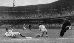 The ball gets past Jackie Robinson while Pirate Danny Murtaugh slides into third during a game on June 9, 1948. Murtaugh later became Pirates manager. (Associated Press photo)