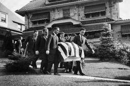 A $5,000 casket containing Bazzano is carried from his Mt. Lebanon home. (Pittsburgh Press photograph)