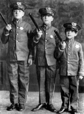 Gene Kelly, 10, is in the center, between brothers Jim, left, and Fred. (Photo credit: Unknown)