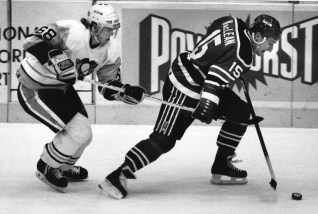 Jaromir Jagr attempts to get the puck from John McLean (New Jersey) in the 3rd period, 1991 (Photo by Robin Rombach, The Pittsburgh Press)