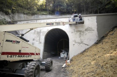 Workers apply a sealant mixture to the exterior of the west portal of Mt Savage for Big Savage Tunnel, 2003 (VWH Campbell/Post-Gazette)