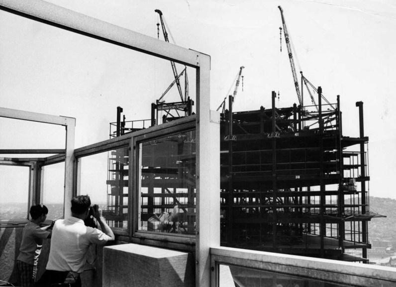 Tourists on the Gulf Building's observation deck photograph the tower's construction. (Harry Coughanour/Post-Gazette on June 30, 1969)