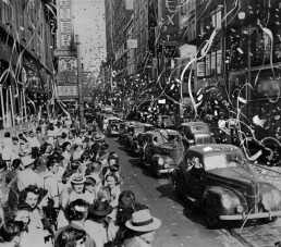 A newspaper artist embellished this picture of the parade along Fifth Avenue, adding additional streamers and confetti. (Pittsburgh Press photo)