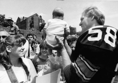 Jack Lambert with a baby at Steelers training camp