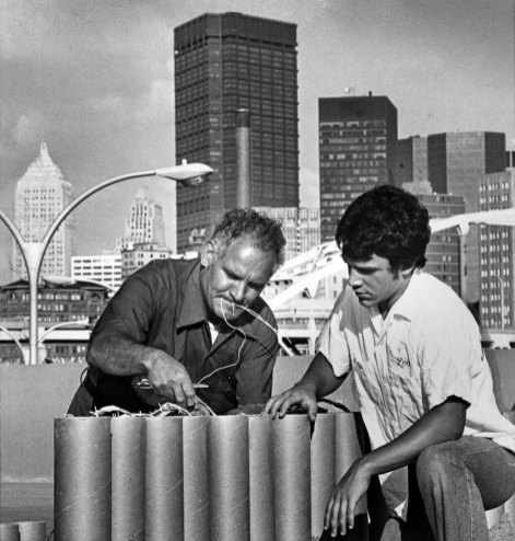 Lou Zambelli Sr. and Jr. work on red, white and blue aerial shells for a Star Spangled Banner display at Three Rivers Stadium on July 2, 1976. (Andy Starnes/The Pittsburgh Press)