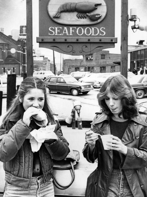 Two students enjoy soup and a sandwich outside Benkovitz Seafood in the Strip, December 1979. (Ed Morgan/The Pittsburgh Press)