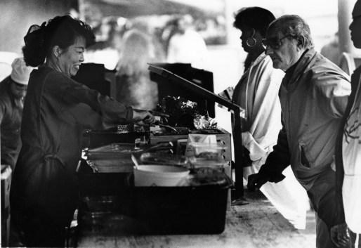 Susan Kang dishes up mung bean pancakes at Sam Bok Oriental Foods in the Strip, April 1993. (Bill Levis/Post-Gazette)