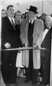 Store opening 1954: Lawrence, center, with Joe Goldstein, right. (Sun-Telegraph photo)