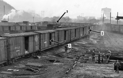 Headless bodies were found in separate boxcars in a railroad yard in McKees Rocks. Pittsburgh Press photo
