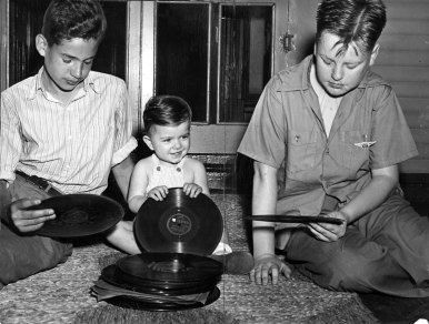 One-year-old Phillip Cutrara with a donated record called Baby Me. (Sun-Telegraph photo)