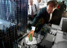 Architect Mike Marcu uses a model to show where a ice skating rink will be installed in 2001. (Steve Mellon/Post-Gazette)