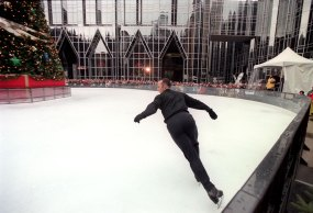 Brian Boitano performs at the opening of the rink on Dec. 18, 2001. (John Beale/Post-Gazette)